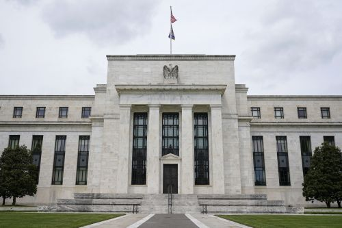 A 'humble' Fed ramps up inflation forecast as prices jump