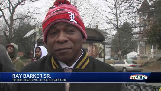 "Honorary street sign revealed in West Louisville for retired police officer ""Sir Friendly C"""