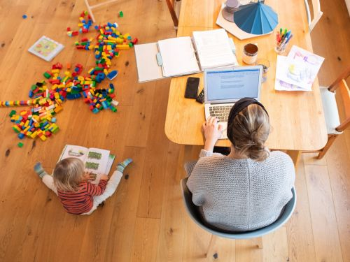 Working mothers could face more negative effects from hybrid work models than their single male counterparts. Experts say the solution is to make remote work the default
