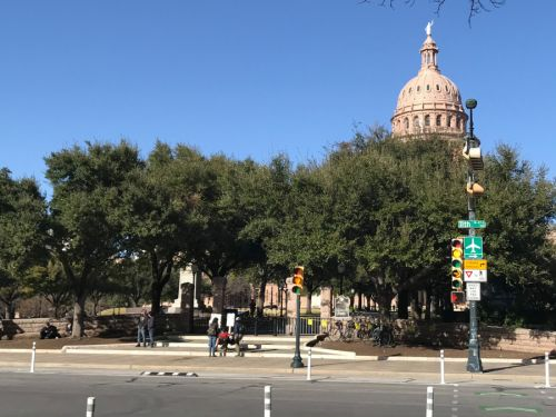 Small group of protesters gather outside of closed, guarded Texas Capitol on Saturday