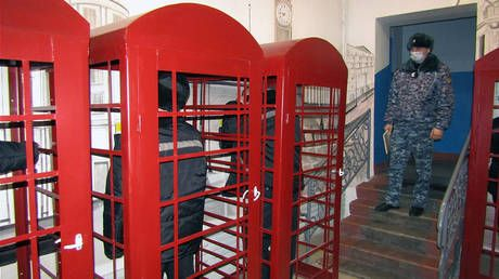 Big Ben behind bars: Siberian prison installs British-style red phone boxes to create 'atmosphere of London' for inmates