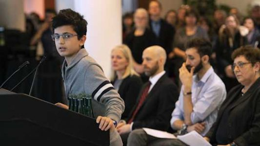 A week after losing his dad in the Iran plane crash, this 13-year-old gave a moving speech