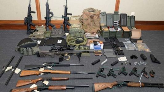 Coast Guard officer accused of stockpiling weapons for planned attack