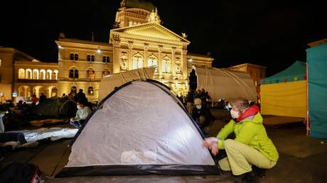 Climate activists chain themselves to objects at 'occupation' camp outside Swiss parliament