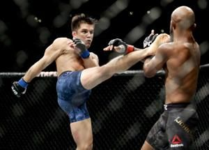The Latest: Hardy's UFC debut ends with DQ loss