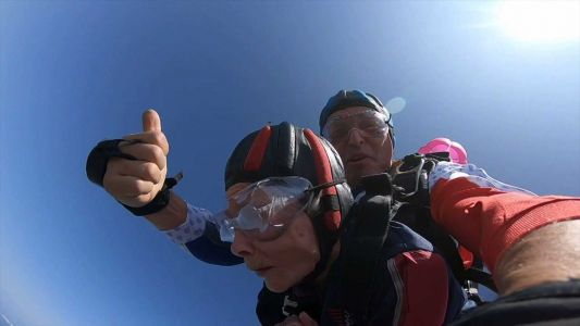 Seattle woman breaks world record for oldest tandem skydiver