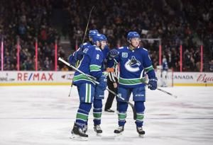 Miller leads Canucks past Blues 3-1 for 9th straight at home
