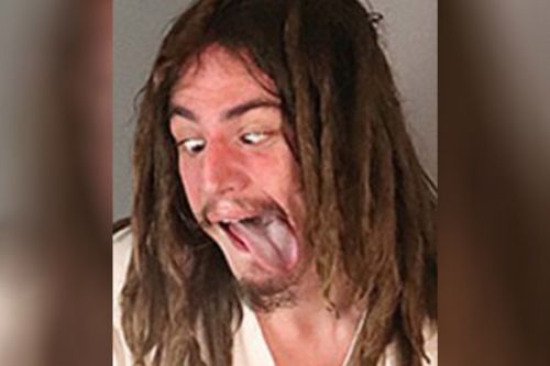 California man arrested for alleged assault sticks tongue out in mugshot