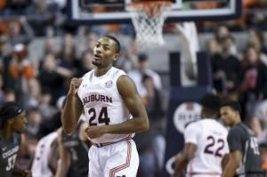 Doughty, Okoro lead No. 16 Auburn past Iowa State 80-76