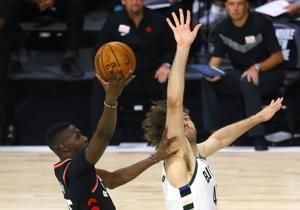 Raptors beat Bucks 114-106; key players for both teams sit