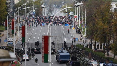 Police use stun grenades to disperse protesters after massive march in Minsk, 'gunfire' reported
