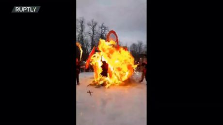 Safety first! Russian traditional spring festival goes wrong as scarecrow EXPLODES & engulfs fire-show performer in flames