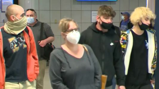 Fully vaccinated people don't have to wear masks indoors in most places