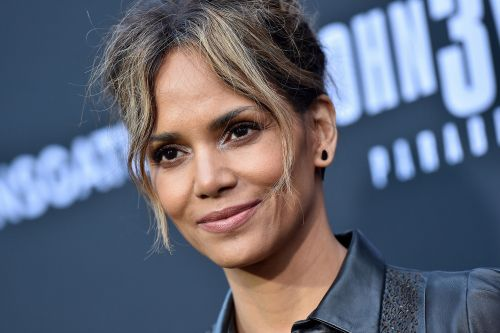 Halle Berry shows her wild side in leopard bodysuit and thigh-high boots