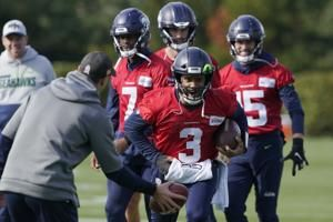 Seahawks put Russell Wilson, Chris Carson on injured reserve