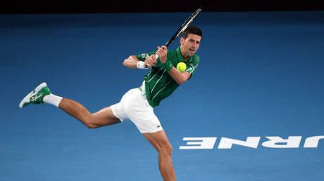 Novak Djokovic defeats German rival to take first step towards defending Australian Open title