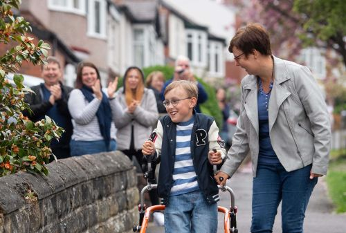 Boy with cerebral palsy completes marathon on his walker, half a mile at a time
