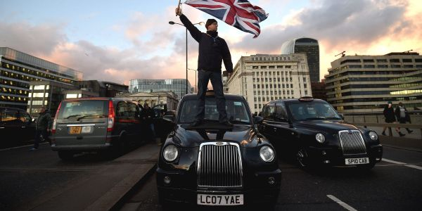 Uber drops 2% after the UK Supreme Court rules that its drivers are employees, not contractors