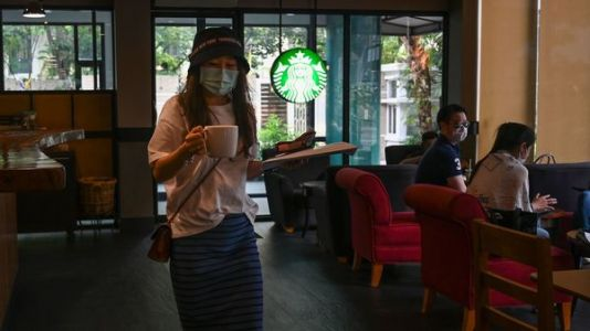 Starting Tomorrow, Starbucks Will Require Employees To Wear Face Coverings At Work