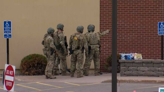 An attempted robbery at a Wells Fargo bank has turned into a hostage situation in Minnesota