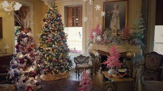 Fourteen different decorators designed the 25 rooms of the mansion for the holidays