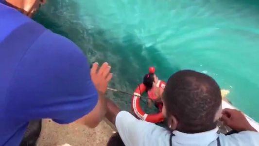 Two men rescue wheelchair-bound woman who fell off dock into ocean