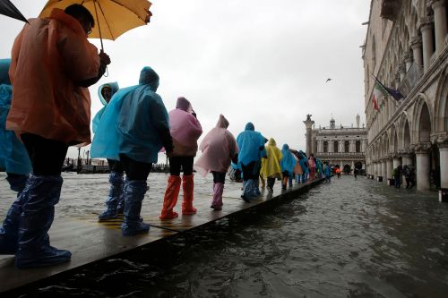 Venice flooding forces tourists, locals to get creative amid high water
