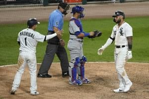 Moncada homers as White Sox win 9-5; Cubs clinch NL Central