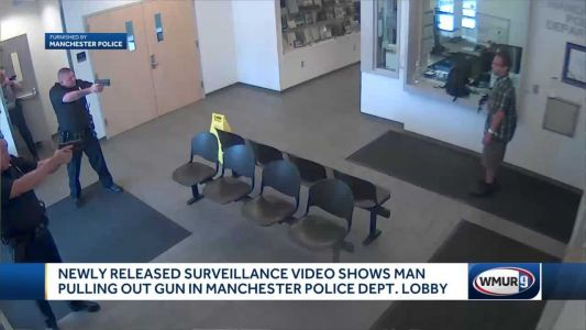 Newly-released surveillance video shows man pulling gun in Manchester police lobby