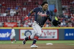 Albies homer, Puig error add up to 3-1 Braves win over Reds
