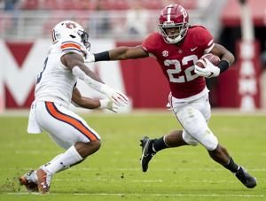 Jones, No. 1 Bama roll past No. 22 Auburn 42-13 minus Saban