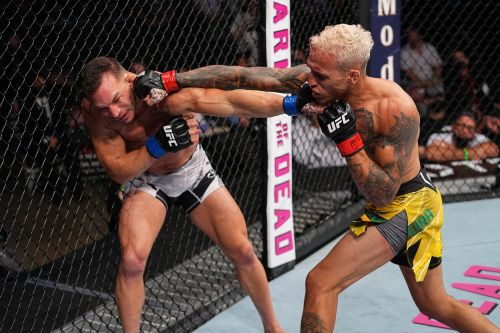 Charles Oliveira stops Michael Chandler at UFC 262 to claim lightweight crown