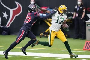 Rodgers throws 4 TDs as Packers beat Texans 35-20