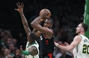 Irving's 27 points, 18 assists leads Celtics past Raptors