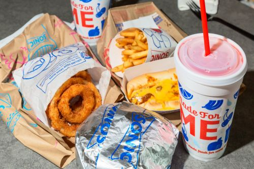 Arby's parent company is acquiring American fast-food icon Sonic in a $2.3 billion deal. We recently visited the burger chain for the first time - here's what it's like to eat there