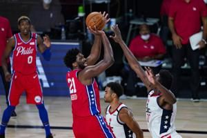 76ers beat Wizards 107-98; Simmons leaves with knee injury