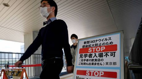 Tokyo enters 'short and powerful' state of emergency as Japan races to contain Covid outbreak before Olympics begin