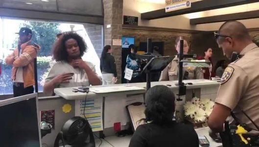WATCH: Officer helps deaf woman obtain Real ID through sign language, helps her pay fee
