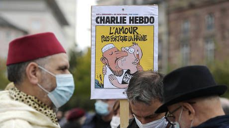 'We cannot let fear prevail': As free speech debates rage after teacher's beheading, French magazine reprints Mohammed cartoons