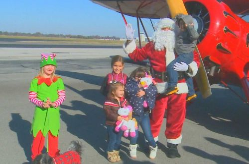 Santa lands in Bowman Field for 12th annual Down Syndrome of Louisville Christmas party