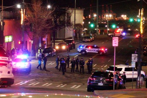 2 injured after police car drives through crowd at street race in Washington