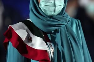 AP PHOTOS: At Olympics opening, zooming in on the outfits