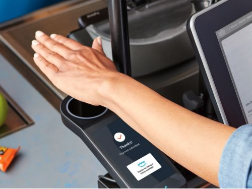 Amazon installed hand scanners in Whole Foods stores that lets shoppers pay with a palm print. Here's how they work