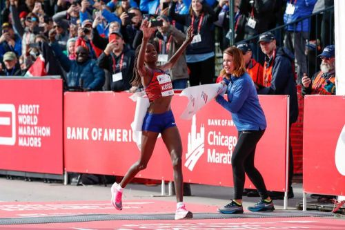 Athletics-Kosgei shatters world marathon record, Cherono wins men's race