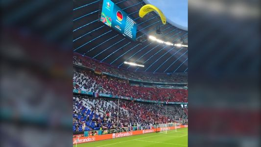 Greenpeace protester parachutes into France-Germany game