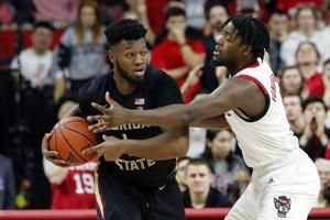 Walker, Williams help No. 8 Seminoles beat Wolfpack 67-61