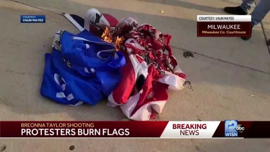Milwaukee protesters react to Breonna Taylor decision with flag-burning, highway march