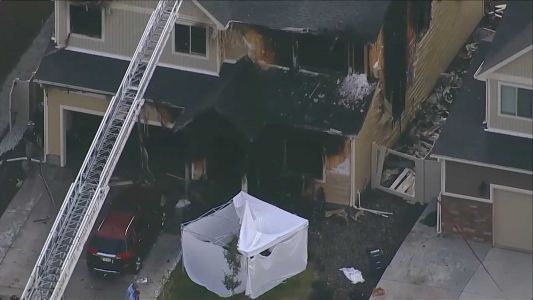 Police: 2 children and 3 adults killed after someone set a Denver home on fire and fled