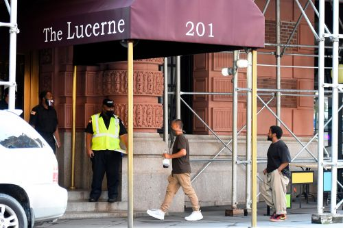 Owner of NYC homeless hotel says there are 'no problems' - as he sells his nearby mansion