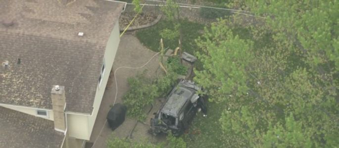 1 killed, 1 injured after SUV veers off road, lands in backyard in Arlington Heights